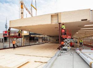 Pioniere des modernen Holzbaus – 230.000 m² Holz- & Holzhybridbauten